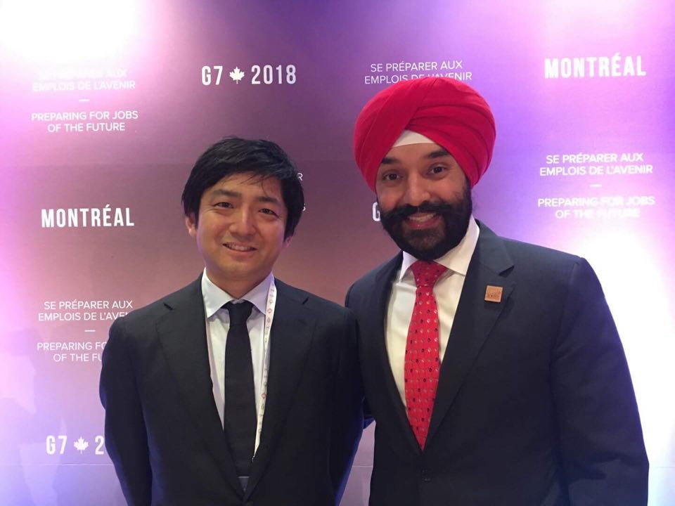 Navdeep Bains, Canada's Minister of Innovation, Science and Economic Development and Yuzo Kano, bitFlyer, Inc.